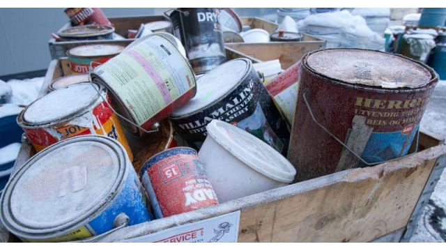Collected Paint Cans with Remainders for Compacting in Screw Compactor